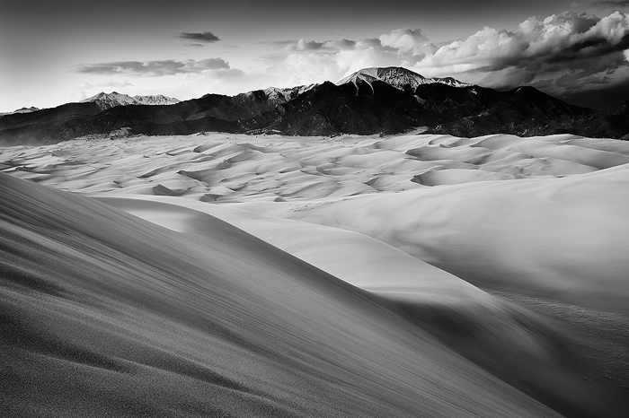Black & White, Black and White, Brown, Clouds, Colorado, Colorado Rockies, Colorado Rocky Mountains, Curves, Great Sand Dunes, National Parks, Orange, Rockies, Rocky Mountains, Sand, Sangre de Cristo Mountains, Smooth, Spring, Sunset, United States