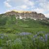 Alpenglow;Blue;Clouds;Colorado;Colorado Rockies;Colorado Rocky Mountains;Crested Butte;Gothic Mountain;Green;Gunnison National Forest;Lupine;Morning;Purple;Rockies;Rocky Mountains;Summer;Sunrise;United States;Wildflowers