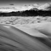 Black & White;Black and White;Brown;Clouds;Colorado;Colorado Rockies;Colorado Rocky Mountains;Curves;Great Sand Dunes;National Parks;Orange;Rockies;Rocky Mountains;Sand;Sangre de Cristo Mountains;Smooth;Spring;Sunset;United States
